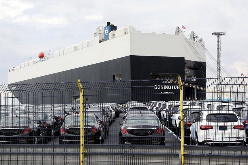 Mercedes-Benz cars parked at the German port of Bremerhaven. US President Donald Trump last Friday threatened to impose a 20 per cent tariff on all imports of EU-assembled cars.
