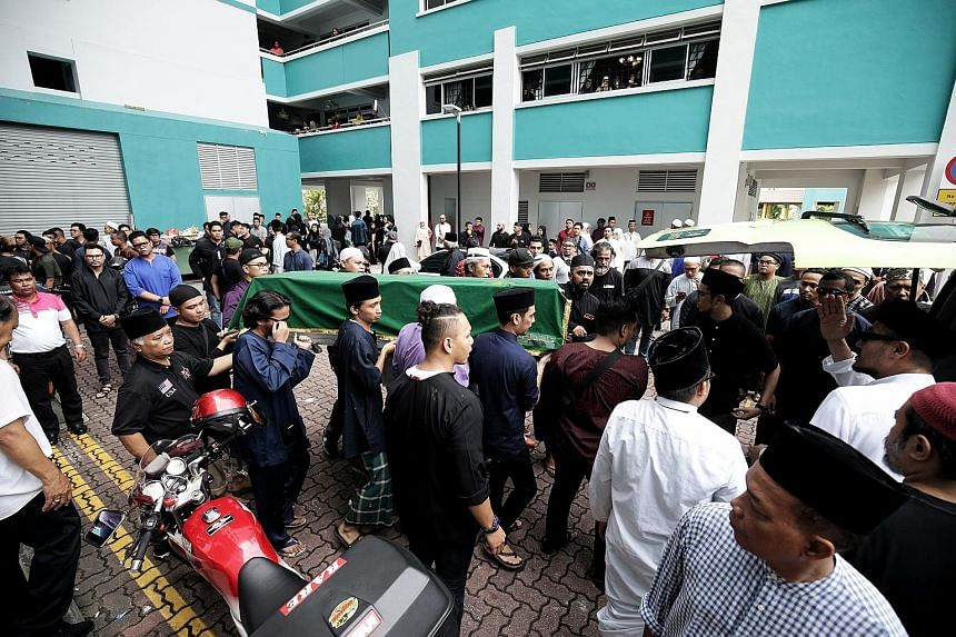 About 200 family members and friends gathered to send commercial diver Mohammad Firdaus Jasni off yesterday evening at the family's flat in Jurong West. Mr Firdaus (left), the eldest of six children, died on the job last Saturday after he was struck