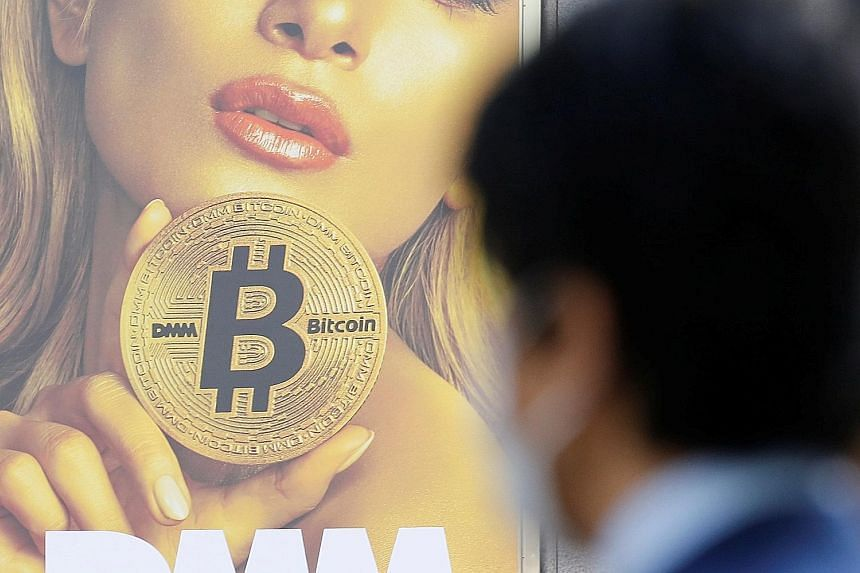 An advertisement for a cryptocurrency exchange in Tokyo. Japan's Financial Services Agency called for improved measures against money laundering at all the exchanges.