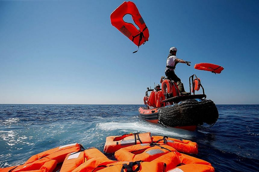 A rescue drill by SOS Mediterranee and Doctors Without Borders near a vessel in the open sea between Lampedusa and Tunisia on Saturday. The urgency of finding a solution to the migrant crisis was highlighted by the plight of the Lifeline, a rescue ve