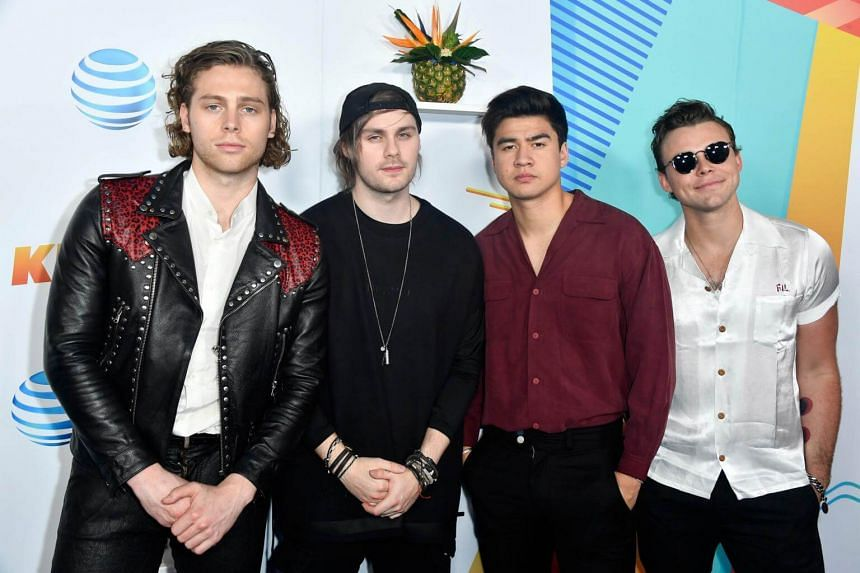 (From left to right) Luke Hemmings, Michael Clifford, Calum Hood and Ashton Irwin of music group 5 Seconds of Summer attending iHeartRadio's KIIS FM Wango Tango by AT&T at Banc of California Stadium, on June 2, 2018.