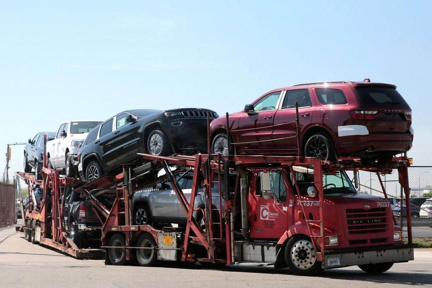 A car hauler transports Chrysler vehicles from the FCA Jefferson North Assembly Plant in Detroit, Michigan on May 25, 2018.