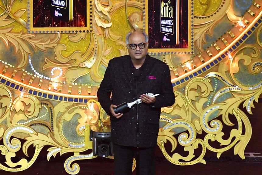 Bollywood film producer Boney Kapoor receives the award on behalf of his late wife and actress Sridevi Kapoor for her contribution to Indian cinema at the Siam Niramit Theatre in Bangkok, on June 24, 2018.