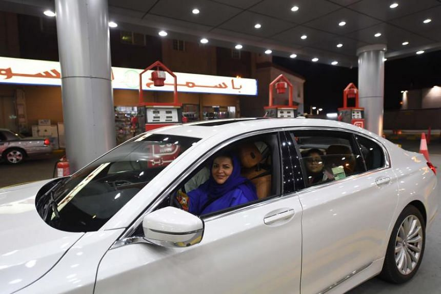Saudi Samira Al-Ghamdi is seen in her car with family driving at food court in the coastal city of Jeddah for the first time.