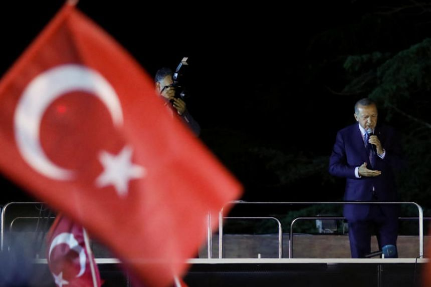 Turkish President Tayyip Erdogan addresses his supporters in Istanbul, Turkey, on June 24, 2018.