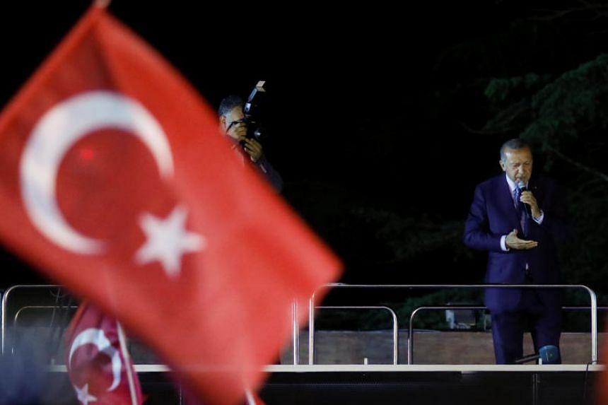 Turkish President Tayyip Erdogan addresses his supporters in Istanbul, Turkey, on June 24, 2018.