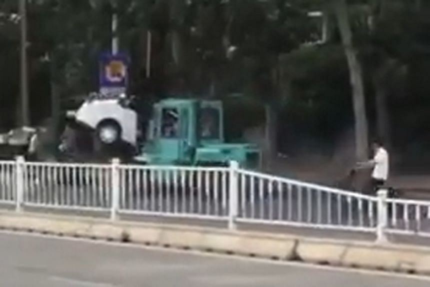 The forklift can be seen in a video ramming into a car and carrying it as it continues crashing into more vehicles on the road.
