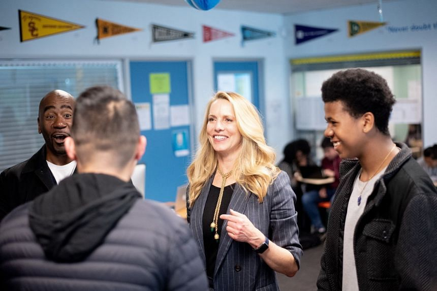 Mrs Laurene Powell Jobs, in Oakland visiting a college preparatory programme she co-founded (above), was listed as executive producer of Kailash, a film which won the US Grand Jury Prize at this year's Sundance Film Festival.