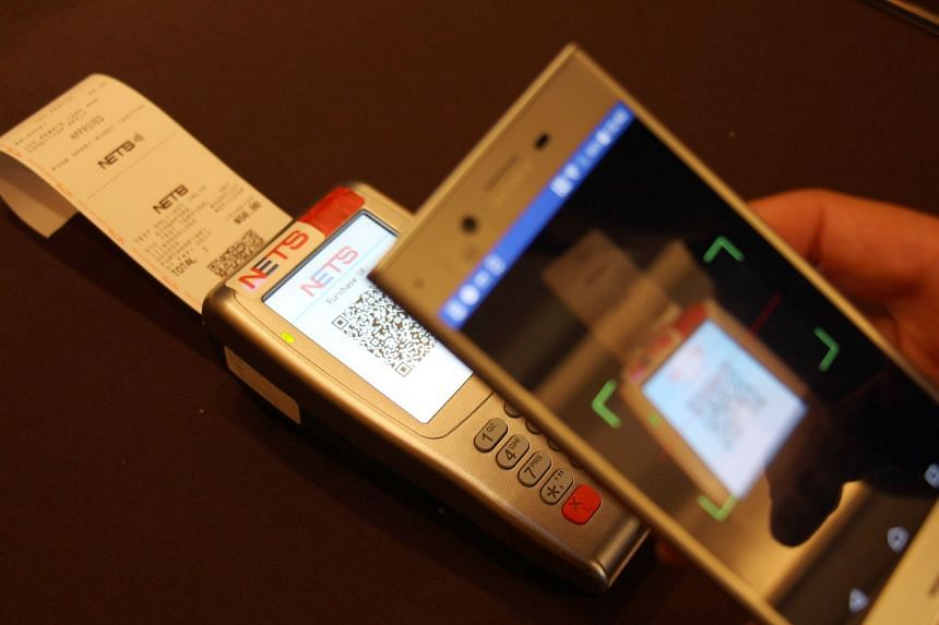 File photo showing Nets payment using a mobile phone. Merchants can now receive a Nets terminal one day after applying for one online instead of submitting physical application forms that take up to two weeks to process.