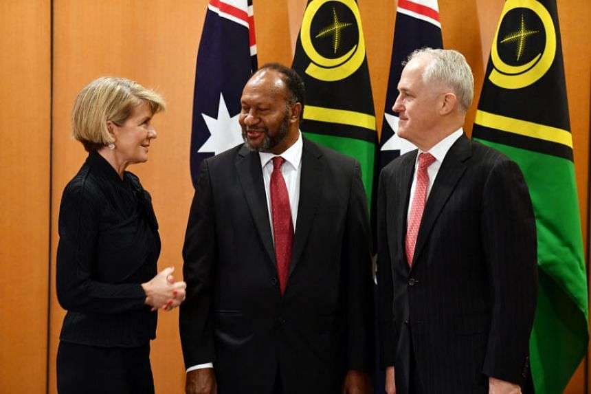 Australian Foreign Minister Julie Bishop speaks to Vanuatu Prime Minister Charlot Salwai and Australian Prime Minister Malcolm Turnbull before a bilateral meeting at Parliament House in Canberra, on June 25, 2018.