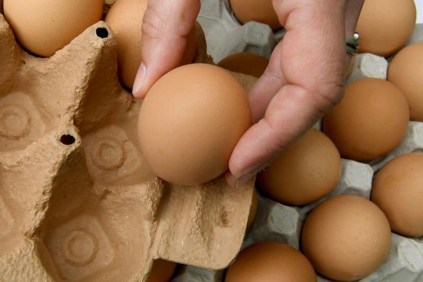 Eggs from a pallet are packed into a cardboard box in Hanover, Germany, on June 12, 2018.
