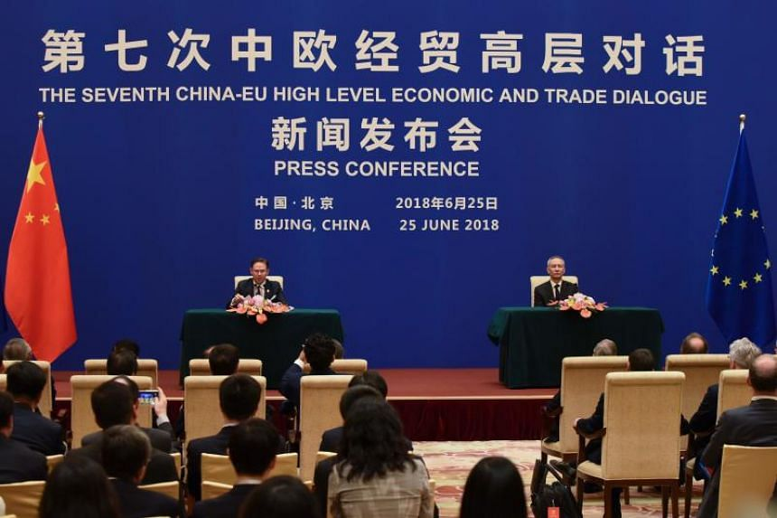 European Commission Vice-President Jyrki Katainen (left) and China's Vice-Premier Liu He at a joint press conference during the EU-China High-level Economic Dialogue at the Diaoyutai State Guesthouse, in Beijing, on June 25, 2018.