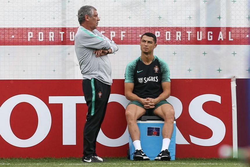 Portugal's national team head coach Fernando Santos and player Cristiano Ronaldo at a training session at the Kratovo training camp in Russia on June 21, 2018.