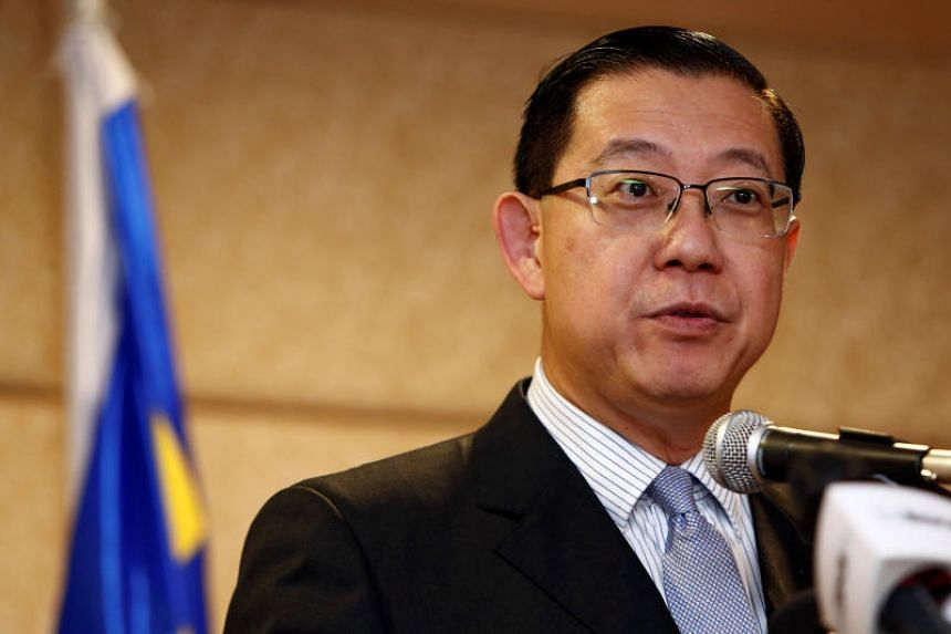 Malaysian Finance Minister Lim Guan Eng was attacked for deviating from the usual government practice of issuing statements in Malay only.