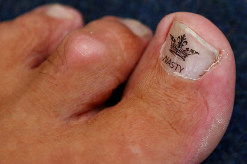 """Alan """"Nasty"""" Nash defeated Ben Woodroffe at the Bentley Brook Inn village pub in Derbyshire, England, to take his 15th toe wrestling championship."""