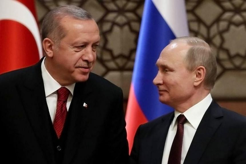 """Russian President Vladimir Putin (right) congratulated Turkish President Recep Tayyip Erdogan, and is ready to continue """"close joint work"""" and dialogue with Turkey."""