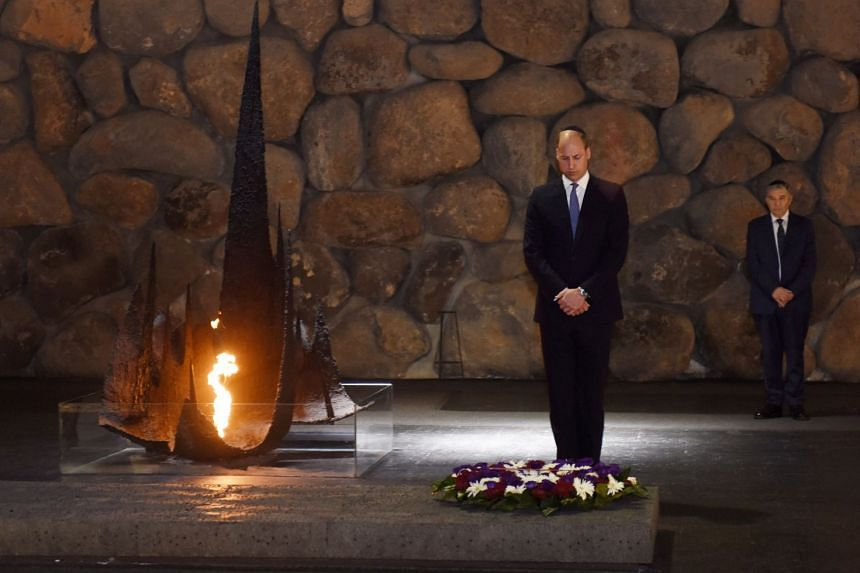 Britain's Prince William pays his respects during a ceremony commemorating the six million Jews killed by the Nazis in the Holocaust, in the Hall of Remembrance at Yad Vashem World Holocaust Remembrance Center, on June 26, 2018.