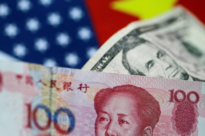 """China's yuan fell as much as 0.61 per cent to its lowest against the US dollar in more than 51/2 months, on news of a reported US government plan to curb Chinese investment in US firms involved in """"industrially significant technology""""."""