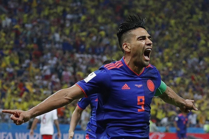 Radamel Falcao of Colombia celebrates after scoring a clinical and hair-raising second goal in the 3-0 win over Poland in Kazan on Sunday. The Colombians now need to beat Senegal in their final Group H game to secure their place in the last 16.