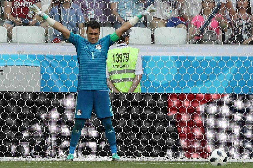 Egypt goalkeeper Essam El Hadary preparing to face a penalty from Fahad Al Muwallad in the 41st minute of their game yesterday against Saudi Arabia. He eventually saved the spot kick, while making World Cup history when he started the inconsequential