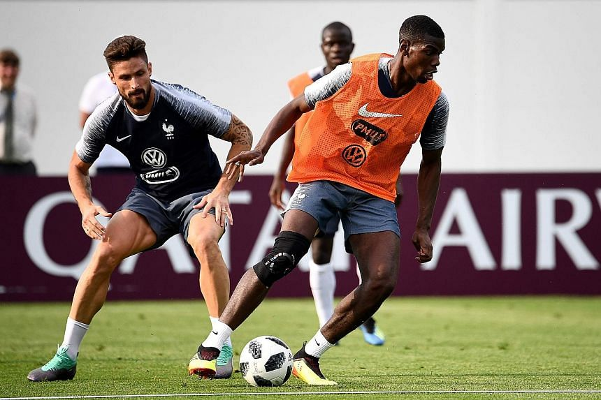 France striker Olivier Giroud (left) participating in a training session with midfielder Paul Pogba at the Glebovets Stadium.