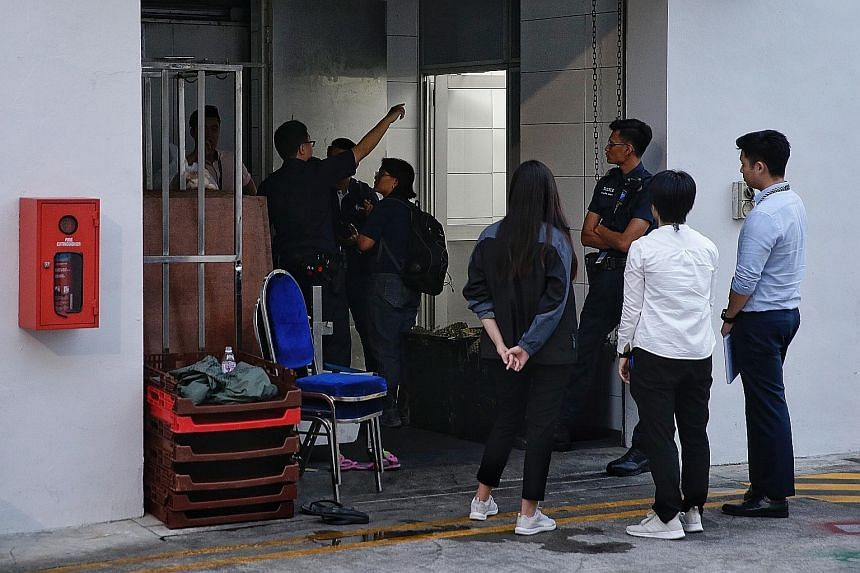 The body of the dead man being carried out of the Bedok South Road premises. The owner of Ng Kian Seng Confectionery died after he fell into a dough-making machine while preparing red bean paste. Investigations under way at Thyme Food and Services on