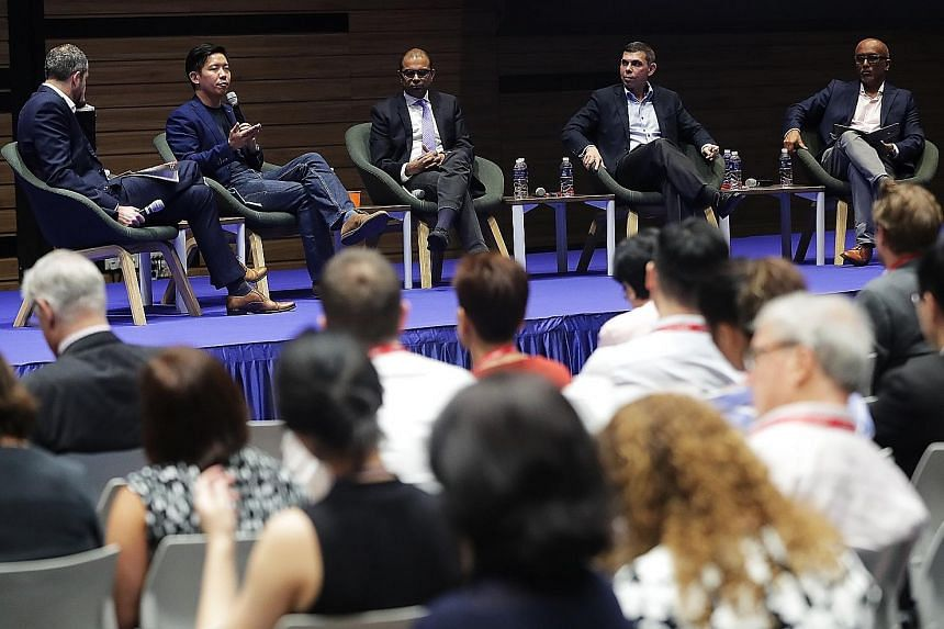 (From left) Moderator Torben Stephan of German think-tank Konrad Adenauer Stiftung; Mr Alvin Tan, Facebook's head of public policy for Asean, Malaysia and Singapore; Senior Minister of State for Communications and Information Janil Puthucheary; Mr Wa