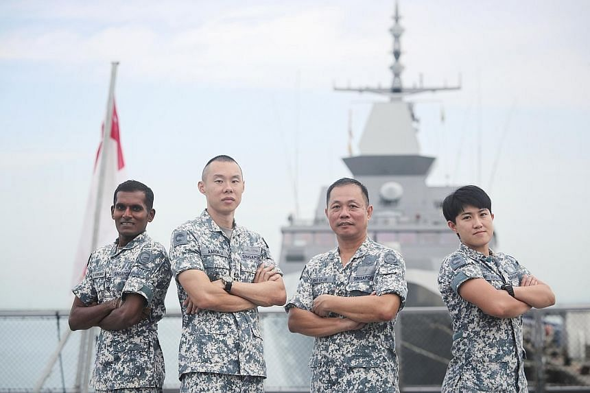 Lieutenant-Colonel Aaron Li Jun Hong (second from left) with some of his crew members - (from left) Military Expert 2 Harikumar K. Rama, Military Expert 4 Lee Siak Kong and Military Expert 1 Juliana Ang.