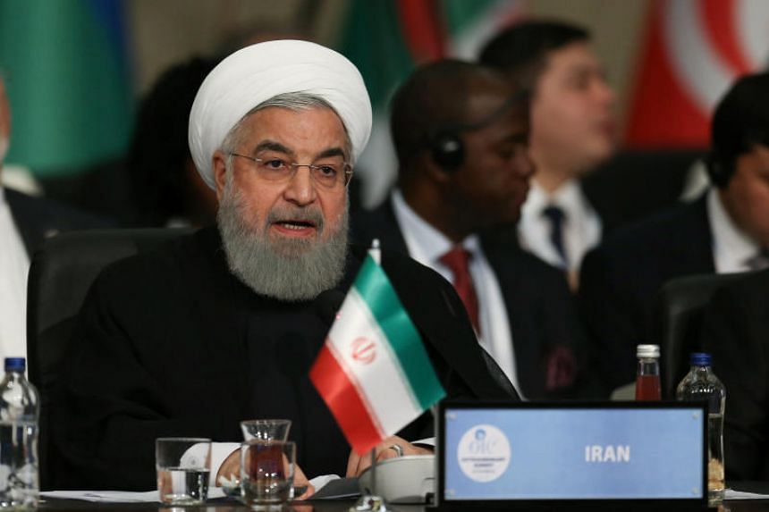 """Iran's President Hassan Rouhani said the fresh US sanctions were part of a""""psychological, economic and political war""""."""
