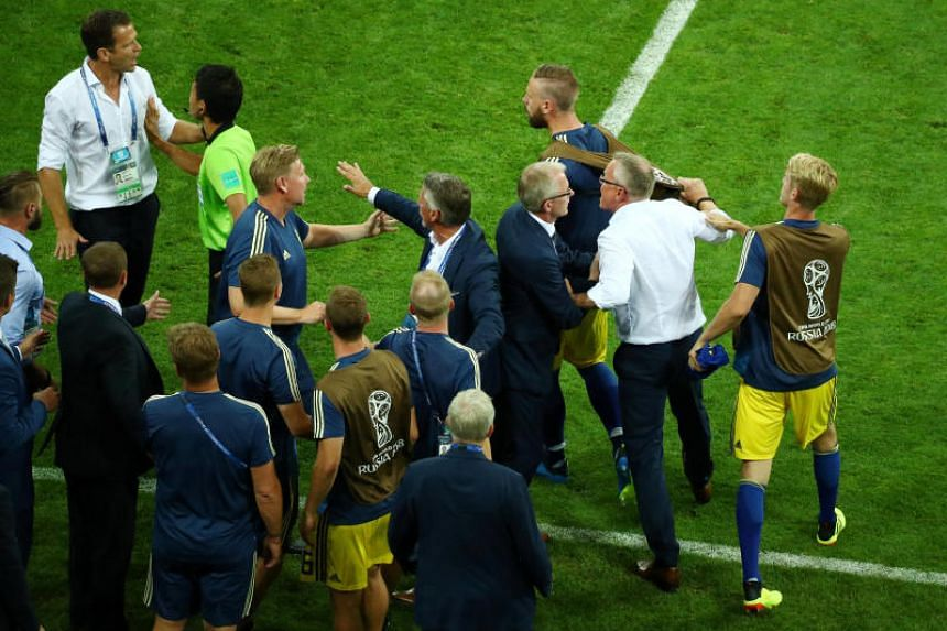 Sweden's coach Janne Andersson and substitute players clash with Germany's team manager Oliver Bierhoff after their World Cup Group F match on June 23, 2018.