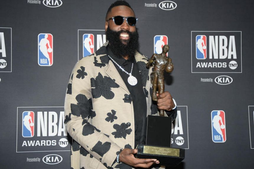 Houston Rockets guard James Harden poses for photos with his MVP award during the NBA Awards show in Santa Monica, California, on June 25, 2018.