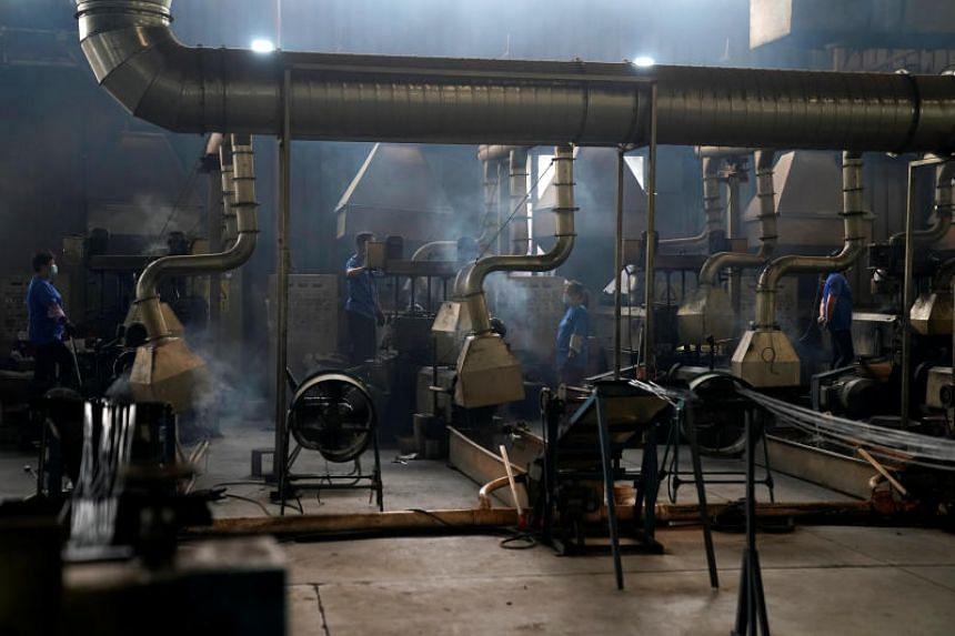 Employees working at Taicang Jinhui Recycling Co., in Taicang of the Jiangsu Province, China, on June 5, 2018.