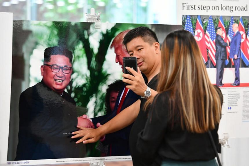 """The mini exhibition was put up on June 25, 2018, as a lead-up to an askST talk session on June 29, 2018, themed """"The Challenges Faced By Today's Photojournalists""""."""
