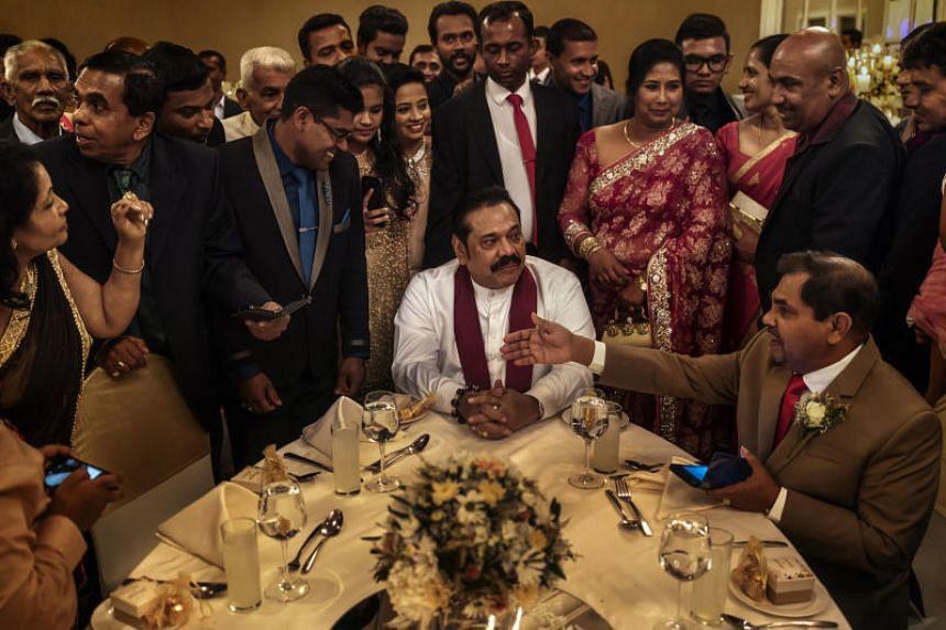 Former Sri Lankan president Mahinda Rajapaksa (centre) at a wedding in Colombo on June 6, 2018.