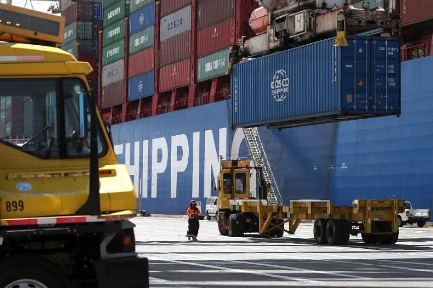 A shipping container from the Hong Kong-based CSCL East China Sea container ship is offloaded at the Port of Oakland, on June 20, 2018 in California.