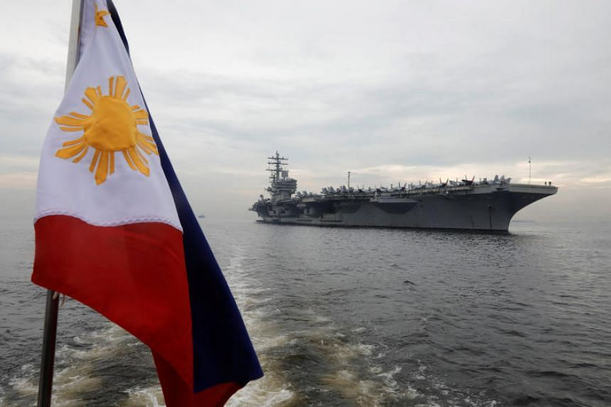A Philippine flag flutters on a ferry transporting journalists to the US aircraft carrier USS Ronald Reagan anchored at Manila Bay, Philippines, on June 26, 2018.