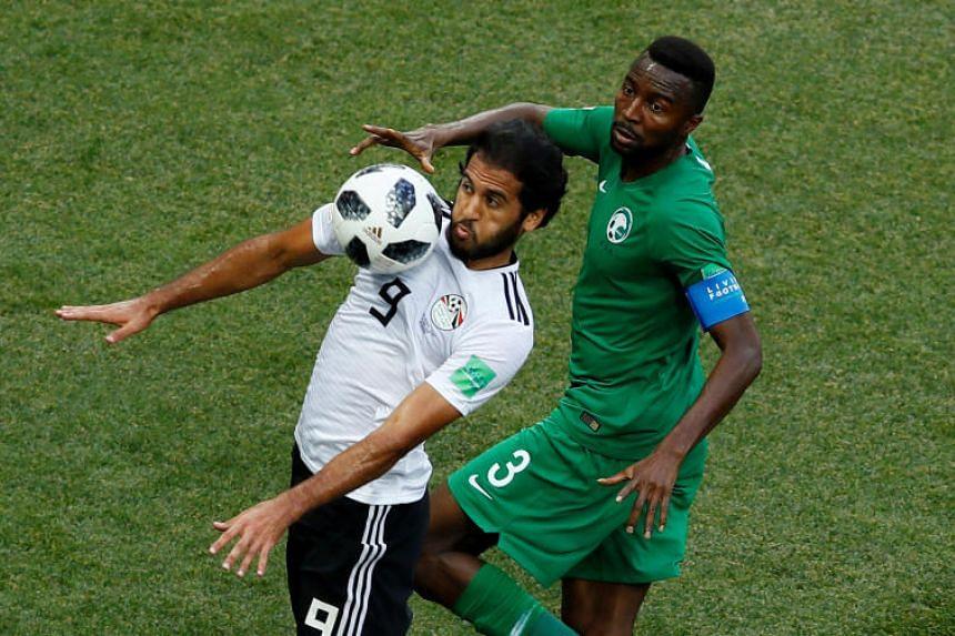 Egypt's Marwan Mohsen in action with Saudi Arabia's Osama Hawsawi in the Volgograd Arena, Volgograd, Russia, on June 25, 2018.
