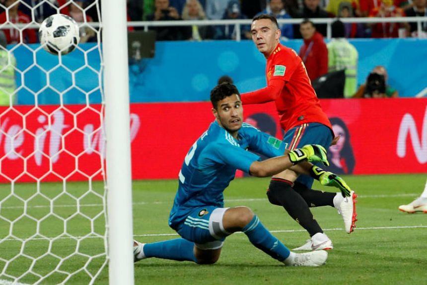 Spain's Iago Aspas scores their second goal at the Kaliningrad Stadium, Kaliningrad, Russia, on June 25, 2018.
