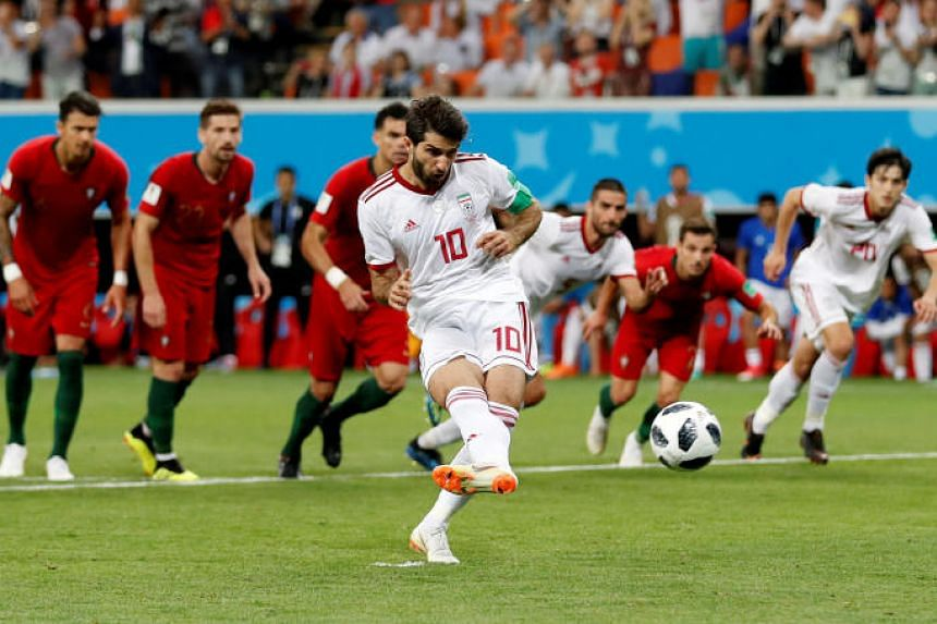 Iran's Karim Ansarifard scores their first goal from the penalty spot at the Mordovia Arena, Saransk, Russia, on June 25, 2018.