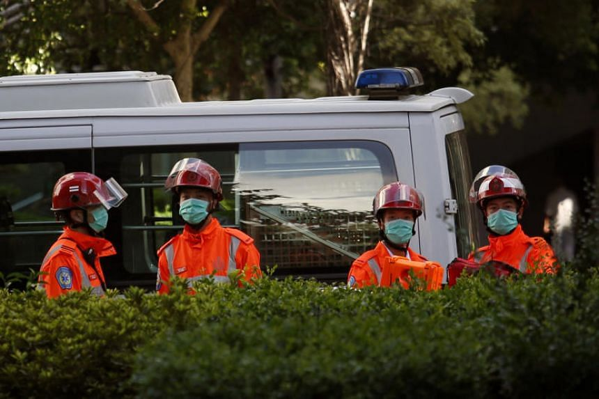 Rescuers being on standby after a woman opened fire and wounded four people at a park outside Taikoo Shing in Hong Kong on June 26, 2018.