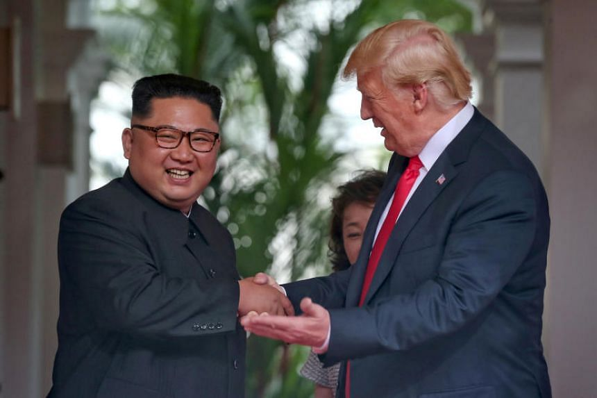 US President Donald Trump and North Korean leader Kim Jong Un meet for their summit at the Capella Singapore hotel in Sentosa on June 12, 2018.