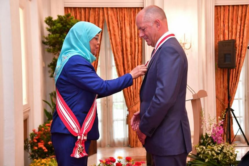 Sir Andrew Witty, former chief executive officer of GlaxoSmithKline plc, was conferred the award by President Halimah Yacob in a ceremony at the Istana on June 26, 2018.