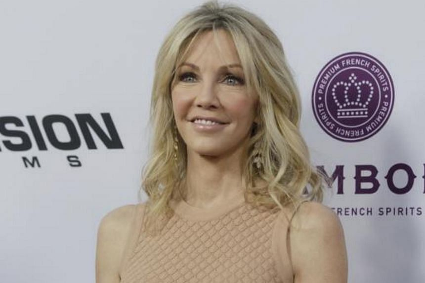 """Actress Heather Locklear, who has appeared in TV shows Dynasty and Melrose Place, was said to be """"heavily intoxicated""""."""