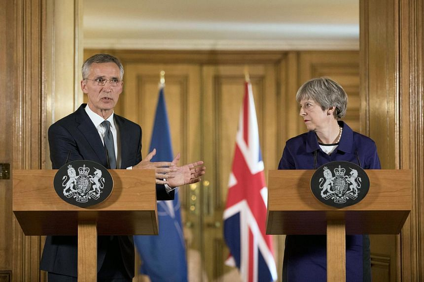 NATO Secretary-General Jens Stoltenberg (left) visiting British Prime Minister Theresa May in London, on 21 June 2018. NATO's 29 Heads of State and Governments will hold a summit in Brussels in July.