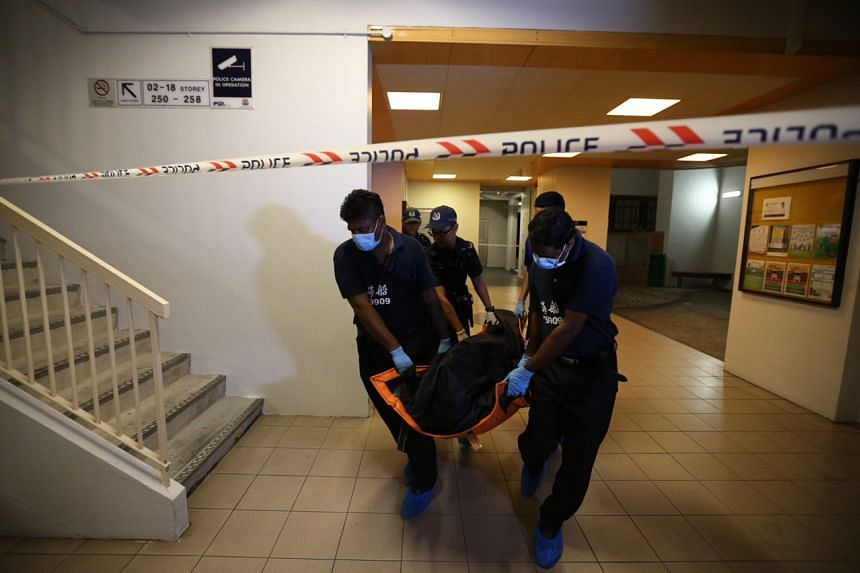 Police removing the body of a 70-year-old woman from a flat in Block 791 Choa Chu Kang North 6 at 1.20 am on June 26, 2018.