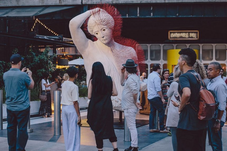 The Amazon, by artist Prune Nourry and on display in Manhattan's meatpacking district (above), is a 3.9m-tall sculpture of a female warrior with joss sticks jutting out of her torso and head like arrow shafts.