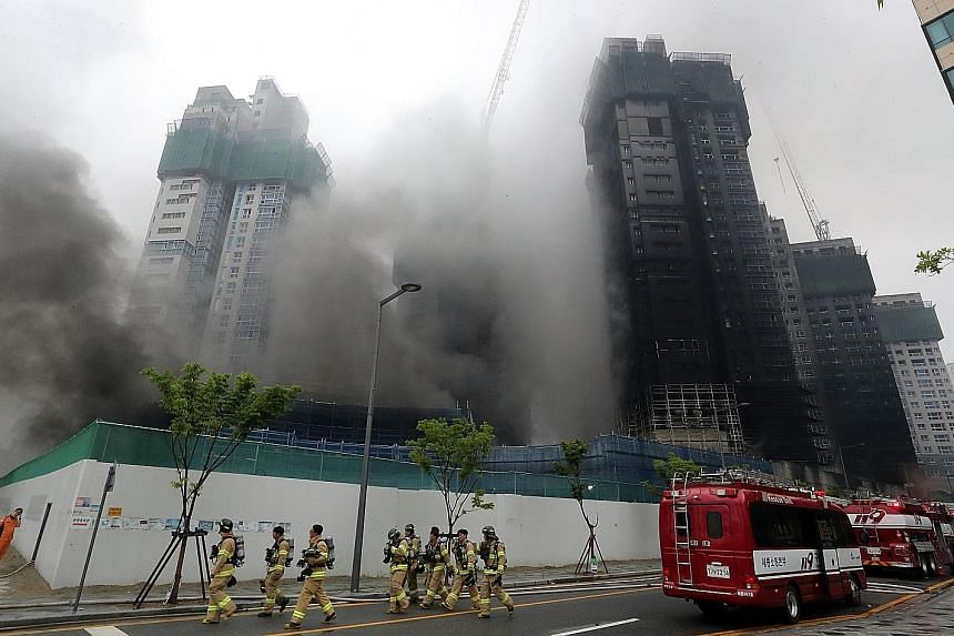 The fire started in the underground parking garage of the building under construction in Sejong city. Firefighters had a hard time fighting the flames as there was no fire extinguishing system in the structure.