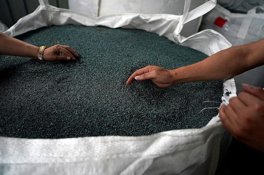Plastic scrap at a Taicang Jinhui Recycling factory, in Taicang, Jiangsu province, China, is turned into pellets used to make manufactured goods.