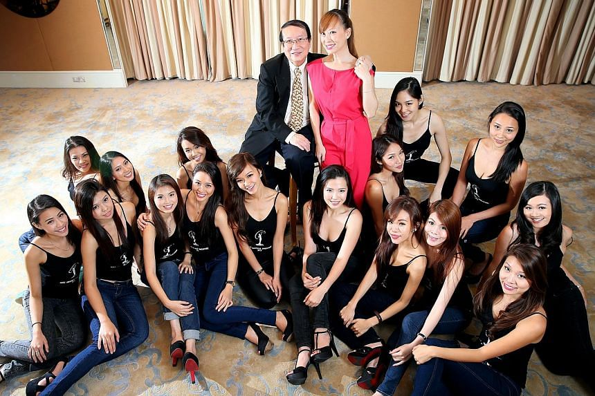 Mr Errol Pang and his daughter Penelope (both centre), co-owners of pageant organiser Derrol Stepenny Promotions, with finalists of the Miss Universe Singapore pageant in 2013.