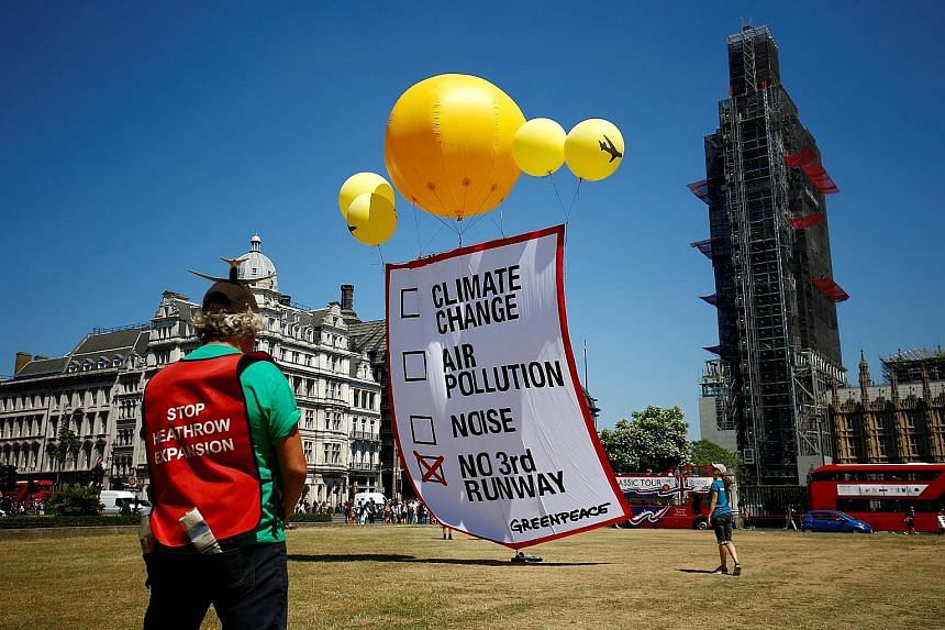 A protest in Britain against the expansion of Heathrow airport yesterday. Approving the project has taken 50 years and is still far from over. Activists worry about its environmental impact.